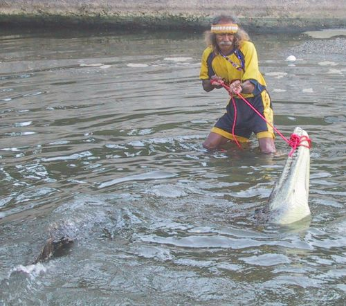 Tamacún wrangling with a crocodile in La Boquita canal on the Playa Municipal
